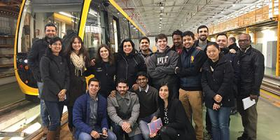 MIT Global Scale Network Students at work site with light rail