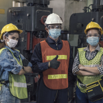 three supply chain professionals in masks